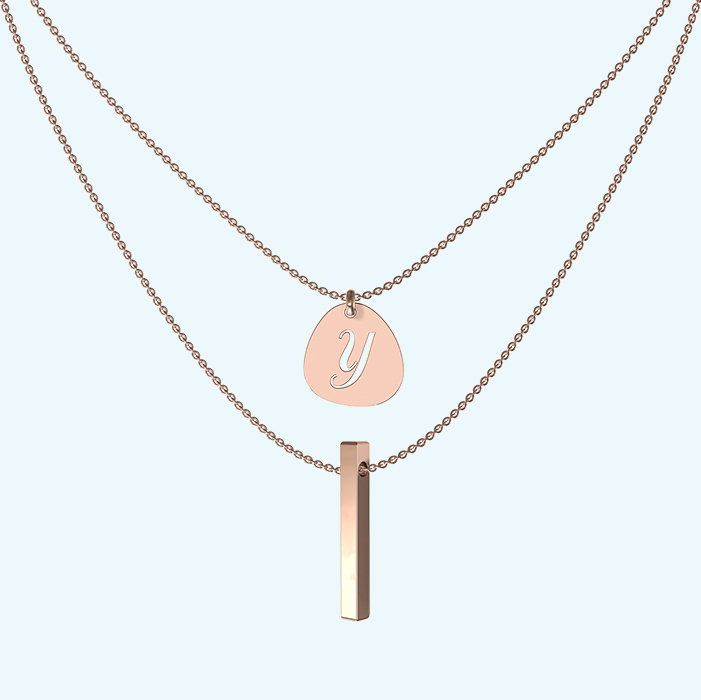 Layered drop bar and pebble pendant necklace in rose gold