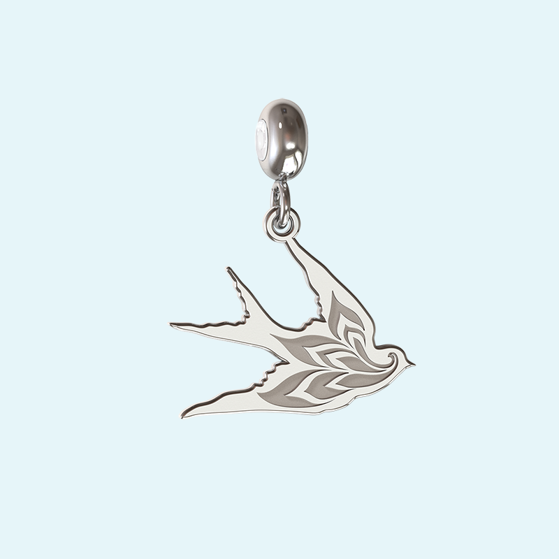 Sterling silver swallow charm