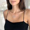A wheel of life necklace worn sits beautifully on her neck