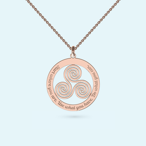 A wheel of Life necklace of inter connected spirals