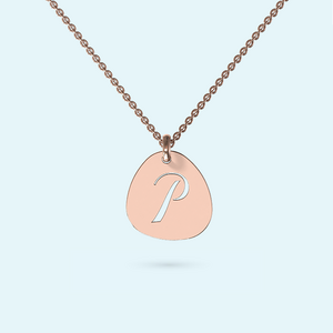 Gold Pebble shaped necklace with cut out initial